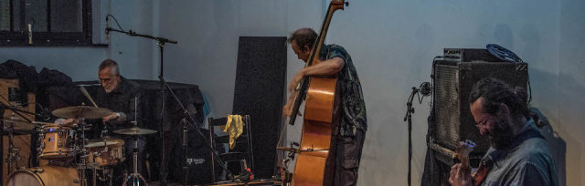 Eddie Prévost / NO Moore  /  John Edwards